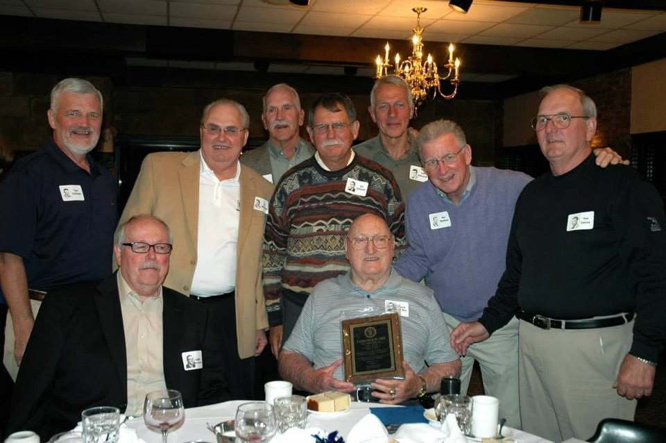 Coach Joe Nee with members of the 1963 SJHS men's basketball team below. The team came within one point of winning the PCIAA, Class B state championship.